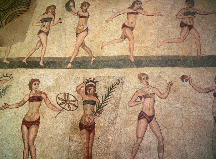 Another mosaic from the Villa Romana del Casale outside Piazza Armerina. The women wear strophia and subligar.