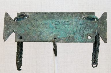 Greek votive inscription to Serapis from a 2nd c. CE tabula ansata (Wikimedia).