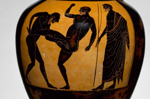 An Attic panathenaic prize amphora (c. 500 BCE) depicting an umpire watching the pankration, which was a combo of wrestling, boxing, and kicking (Picture via Wikimedia, but vase is at the Met NYC).