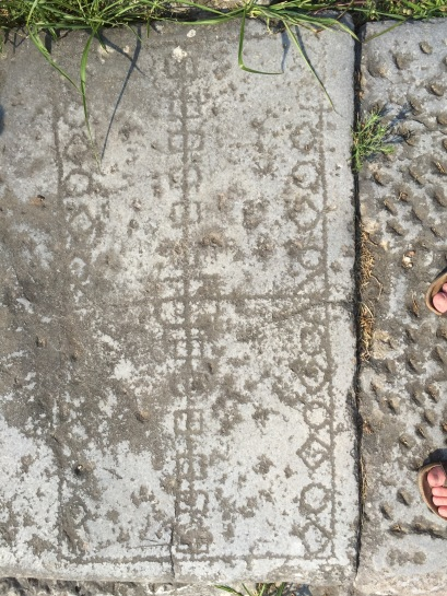 Game--board from Roman Philippi and the classic archaeologist foot selfie (Photo by Sarah E. Bond)